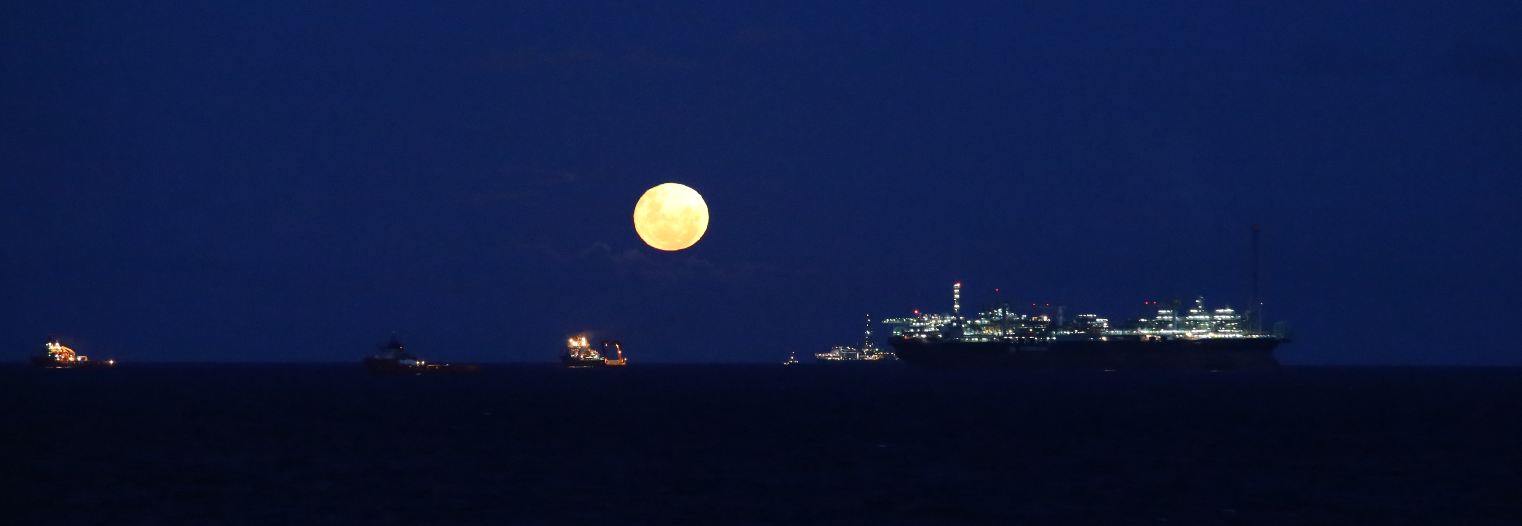 Full moon at the Campus Basin Oil Field in Brazil.